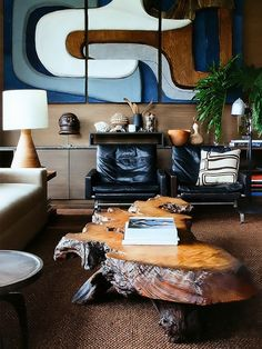 ♂ Masculine interior design with nature wood table dark brown carpet, abstract wall deco and black sofa