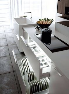 Love the drawers in a modern kitchen