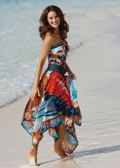 Swimwear, dress. It's actually a skirt shown here on top of a matching bathing suit. But you could turn it into a strapless dress or a poncho style dress.