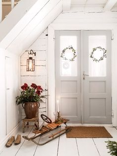 Love this entryway foyer with gray painted doors and Shiplap.