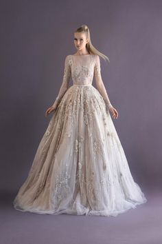 Paolo Sebastian sleeved lace ball gown encrusted with a million dollars worth of diamonds and 3D flower petal detail.