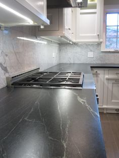 Soapstone is named so because its surface is soft like a dry slab of soap. The softness of soapstone is mainly owing to the presence of talc in it. Soapstone countertops are popular mainly because they have a non porous surface. Soapstone Countertops, Soapstone Kitchen, Kitchen Countertops, Kitchen Cabinets, Laminate Countertops, Kitchen Backsplash, Backsplash Herringbone, Granite Backsplash, Home Design Software