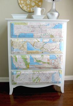 Attach any paper maps to your drawers. Domestic Ease recommends using product called Mod Podge to adhere maps to the wood. Great idea!