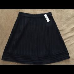 """A-Line Skirt BRAND NEW. The alternating mesh and stripe definitely makes a statement in a classic black color. From the top of the waist band to the hem of the dress it measures 21 1/2"""" inches and waistband measures 29.5"""". It is lined and is made of 100% polyester. The last 3 1/2"""" inches of the hem of the skirt are not covered by the lining. J. Crew Skirts A-Line or Full"""