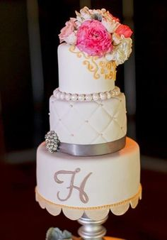 Monogrammed white grey and pink wedding cake (Photo by Toby Tucker)