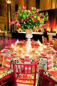 gorgeous, bright table setting | color | pattern/texture | bright pink chairs | seat cushions | stunning floral arrangement