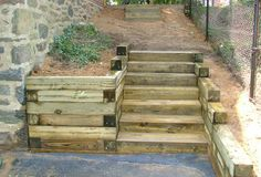 Railroad Tie Steps & Retaining wall Source by micheymade Railroad Tie Retaining Wall, Retaining Wall Patio, Building A Retaining Wall, Landscaping Retaining Walls, Outdoor Landscaping, Tiered Landscape, Small Garden Landscape Design, Landscape Stairs, Landscape Timbers