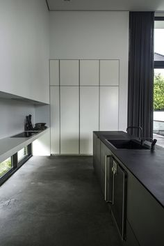 this modern concrete house by ardess caught my attention right away mostly because of what is