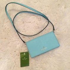 Kate Spade iPhone Crossbody Purse Brand new, authentic, never used Kate Spade iPhone Crossbody Purse in blue. kate spade Bags Crossbody Bags