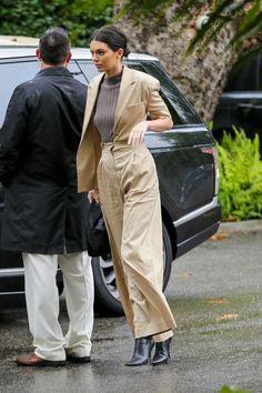 Kendall Jenner wearing Prada Mini Hobo Bag and Balenciaga Knife Boots