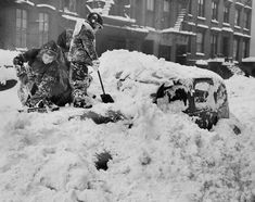 Betty Lou and brother Patrick O'Connor attempt to dig out their father's car out of the snow with toy shovels on 29th St. and Second Ave. after snow storm blankets city on Dec. 27, 1947.