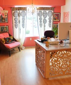 Papaya's cheery office in bright coral. I really would love a filigree desk like this!