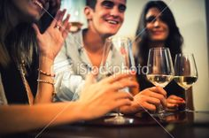 Group of friends toasting during an italian aperitif Royalty Free Stock Photo