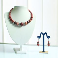 Set up Jewelry 'unique handcrafted jewelry from Arijeta'. They have a unique design with Faceted faceted ruby agate beads in rondelle shape and metal parts.  Material: They are made of faceted ruby agate rondelle beads and Metal.