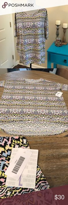 🤩NWT! Irma!! NWT! Aztec printed Irma!! Has pink, yellow, black, blue and white in it! Perfect with leggings!! LuLaRoe Tops Tunics