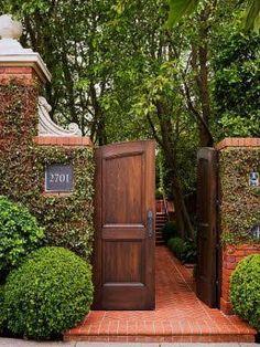 Beautiful gate landscaping design.
