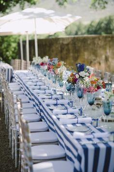 Blue stripe summer wedding reception | SouthBound Bride www.southboundbride.com/something-red-something-blue-la-petite-dauphine-wedding-jules-morgan-ndoni-david  Credit: Jules Morgan