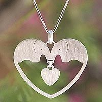 Discover unique handcrafted treasures. Every purchase will help UNICEF save and improve children's lives and help support talented artisans. Sterling silver heart necklace, 'Elephants in Love'