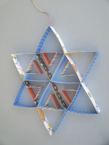 Star of David Hanukah kids craft made from folded paper triangles. Copyright Pamela Maxwell 2013