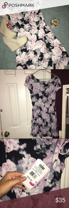 NWT floral dress Black floral dress size 7 (medium). NWT never worn!! Willing to negotiate feel free to ask questions in the comments :) Dresses Mini