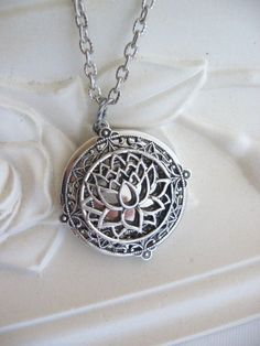 Etsy listing at https://www.etsy.com/listing/172053141/lotus-flower-locket-silver-locket-silver