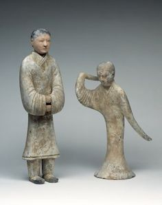 Standing female servant and dancer. The two figures were originally painted in bright colours and formed part of similar group of earthenware figures which served as tomb furniture and were made especially for the tombs of members of the upper class. Standing female servant and dancer; grey earthenware with traces of painted decoration; China, Western Han dynasty (206 BC - AD 8), 1st half of 2nd century BC;  h (servant) 61.5 cm, h (dancer) 49.5 cm. Photo: A. Dreyer