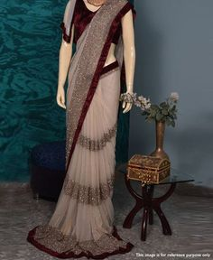 * Saree Fabric : Georgette * Saree Color : Beige * Saree Length : M * Saree Work : Fancy Patta * Blouse Fabric : Velvet * Blouse Color : Maroon * Blouse Length : 1 M * Look : Designer Saree * Wash Care: Dry Clean * Delivery Time: S Saree Designs Party Wear, Party Wear Sarees, Saree Blouse Designs, Georgette Saree Party Wear, Georgette Sarees, Sari, Saree Dress, Lace Saree, Outfits