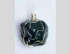 Beautiful Bloodstone crystal pendant. A handcrafted, one-of-a-kind creation.    Free standard shipping in the U.S.    Bloodstone is associated with both the root chakra and the heart chakra. It is known as the stone of courage. It improves physical strength, enhances self-esteem, and calms anxiousness.     Thank you for visiting my shop! | Shop this product here: http://spreesy.com/msjoycependants/4 | Shop all of our products at http://spreesy.com/msjoycependants    | Pinterest selling…
