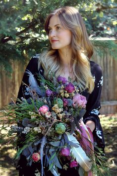 Dried bridal bouquet featuring flowers, seedpods, branches, lichen, feathers, seashells, vintage millinery, and more