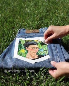 Frida Kahlo self-portrait painting on denim jeans tape peel Painted pocket painted jeans pocket jeans denim frida frida kahlo artwork leaves fabric painting painted fabric diy Frida Kahlo Artwork, Kahlo Paintings, Painted Denim Jacket, Painted Jeans, Painted Clothes, Diy Clothing, Custom Clothes, Diy Clothes Jeans, Diy Clothes Videos