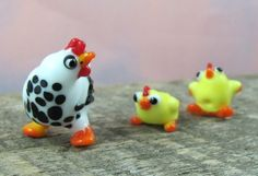 A black and white lampwork glass hen with two bright yellow chicks is a set of three beads that no one else out there will have. At least none