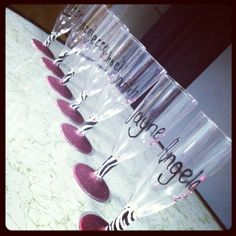 Bachelorette party champagne glasses I made. Glitter spray paint and zebra duct tape.... Simple, fun, and classy!