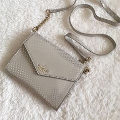 Kate Spade Purse PRICE FIRM Kate Spade Small Purse in beige and gold dots. Has detachable long strap with chain. Crossbody  or clutch. Had Credit card slots in purse with snap closure. Super darling! kate spade Bags