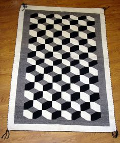 While I was pinning hexagons to my Science and Nature Board, I came across this amazing Navaho Quilt.  It was made in the '50s and is for sale for a mere $2,400!