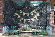 Army party decorations - camo net really sets the backdrop for an army themed party and the helmuts are a great way to serve the food!