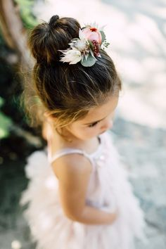 flower girl hair - photo by Plum and Oak http://ruffledblog.com/a-california-garden-wedding-with-romantic-florals