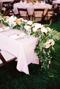 Brides.com: Unique Centerpiece Idea: Fresh Flower Runners. Honey of a Thousand Flowers, a Salt Lake City-based florist, adorned a single-sided table with a lush display of peonies and bright greens.