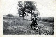 Johnny Cash, A.J. Henson, J. E. Huff and Stanley Jones at the Henson Farm in Dyess Arkansas 1947.