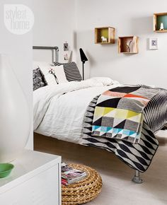 white bedding with graphic throws