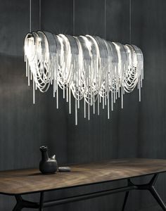 The Volver LED suspension light has been designed by Studio 14 for manufacturer Terzani. This luxurious LED suspension light is Terzani's first, combining Luxury Lighting, Unique Lighting, Interior Lighting, Lighting Design, Deco Luminaire, Luminaire Design, Light Art, Lamp Light, Pendant Lamp