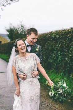 Jess wears an Eliza Jane Howell dress for her winter village hall wedding. Photography by Emma Boileau.