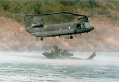 CH-47C Chinook recovering a AH-1 Cobra out of the drink