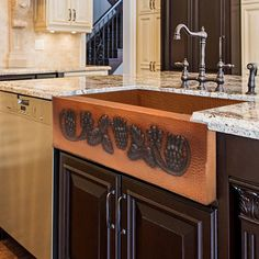 Starting at $1,275 - The Berry Vine Copper Farmhouse Sink has a beautiful apron front design in a two-tone finish. It is entirely handcrafted by our artisans from heavy-gauge copper to assure unsurpassed quality and durability. Copper is naturally antibacterial, and is a good environmentally-friendly choice. Copper Farmhouse Sinks, Farmhouse Sink Kitchen, Copper Kitchen, Apron Designs, Custom Cabinets, Front Design, Countertops, Berry, Beautiful