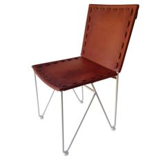 A fresh take on a traditional dining chair, only with saddle leather and steel rod base. Materials: Steel base powder-coated in white with natural leather seat.