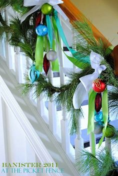 Christmas Banister Decorated with Blue, Green Ornaments, Garland and Ribbon