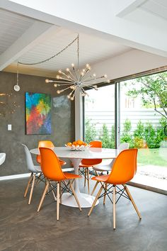 Riviera Resort Palm Springs. Dining Room. Orange Eames Chairs. Aalto Table. Sputnik Chandelier. Modern Bright Colors