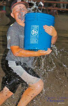 The holey bucket race is always popular at the Barn Yard Olympics.