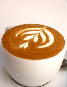 Learn how to make beautiful latte art with steamed milk and espresso.