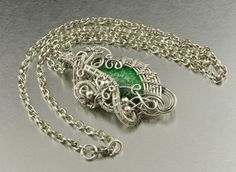"""Stunning wire wrapped pendant, with beautiful unique green Jasper, in a original wire wrapped design. Beautiful, remarkable pendant, for a woman who likes unique and exclusive jewelry :) Length of the chain - 50cm (19.69"""") Pendant diameter is - 6 cm x 3 cm (2.36"""" x 1.18""""); Material: 925 sterling silver plated copper wire ;  On request I make a similar pendant in other material - silver, copper, brass, silver-plated copper, bronze. Interested persons are welcomed to contact :)"""