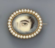 Christie's. (2002). ENGLISH SCHOOL, CIRCA 1830 -A left eye with brown iris, lock of brown hair, sideburn and cloud surround. Retrieved November 29, 2015, from http://www.christies.com/lotfinder/lot/english-school-circa-1830-a-left-eye-4020356-details.aspx?from=salesummary&intObjectID=4020356&sid=718acb30-5ae0-46f2-a1a9-5a4e6d12a7e5